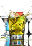 Mixed drinks yellow splash Royalty Free Stock Image