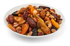 Mixed dry fruits on a plate Stock Photos