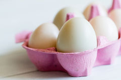 Mixed duck eggs in pink egg box Royalty Free Stock Image