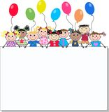 Mixed ethnic children. Mixed ethnic boys and girls holding a placard Stock Image
