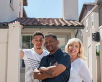 Mixed ethnic family posed in backyard with arms crossed. Stock Photo