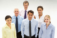 Mixed ethnic group of business people. Smiling up to camera Royalty Free Stock Image