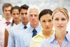 Mixed ethnic group business people. Standing indoors Royalty Free Stock Images
