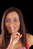 Mixed Ethnic Woman with Finger to Lips Stock Images