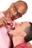 Mixed ethnicity gay couple Royalty Free Stock Image