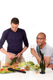 Mixed ethnicity  gay couple kitchen Stock Image