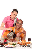 Mixed ethnicity  gay couple kitchen. Attractive young mixed ethnicity gay, homosexual couple, Caucasian and African American in kitchen, preparing breakfast Stock Image