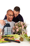 Mixed ethnicity  gay couple kitchen Royalty Free Stock Photo