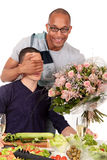 Mixed ethnicity  gay couple kitchen. Attractive young mixed ethnicity gay, homosexual couple, Caucasian and African American in kitchen, celebrating valentine at Stock Image