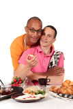 Mixed ethnicity  gay couple kitchen. Attractive young mixed ethnicity gay, homosexual couple, Caucasian and African American in kitchen, preparing breakfast Royalty Free Stock Images