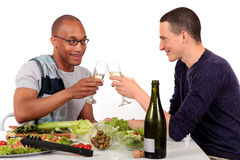 Mixed ethnicity  gay couple kitchen Royalty Free Stock Images