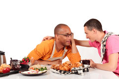 Mixed ethnicity  gay couple kitchen. Attractive young mixed ethnicity gay, homosexual couple, Caucasian and African American in kitchen, preparing breakfast Royalty Free Stock Photo