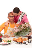 Mixed ethnicity  gay couple Valentine. Attractive young mixed ethnicity gay, homosexual couple, Caucasian and African American in kitchen, celebrating Valentine Royalty Free Stock Photography