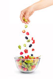 Mixed falling berries and fruits in bowl Royalty Free Stock Images