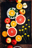 Mixed festive colorful tropical and citrus fruit sliced over bla Royalty Free Stock Photo