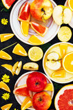 Mixed festive colorful tropical and citrus fruit sliced over bla Stock Image