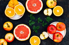 Mixed festive colorful tropical and citrus fruit sliced over bla Stock Photo