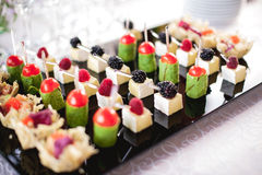 Mixed fingerfood canapes on appetizer table stock photography