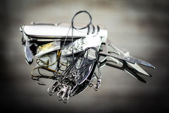 Mixed fishing lure and swiss army knife Stock Photography