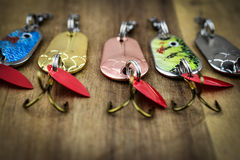 Mixed fishing lure and swiss army knife Royalty Free Stock Images