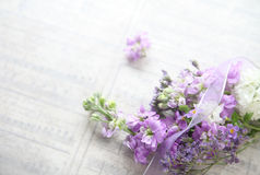 Mixed flowers with old music background Stock Photos