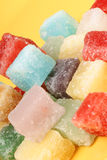 Mixed fondant candies. Colorful mixed fondant candies over a yellow background. Selective soft focus stock photography