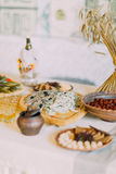 Mixed food and fish meal served in traditional rural style on table with white tablecloth Stock Photography