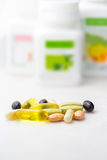 Mixed food supplement pills close-up, omega3, carotine, vitamins Royalty Free Stock Image