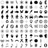 Mixed Forms. The picture shows a lot of black icons like, waves, drops, animals, hands, feet, notes and other signs isolated on white Royalty Free Stock Photos