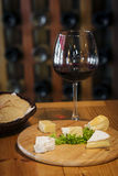 Mixed french cheese platter with bread and wine Royalty Free Stock Images