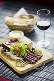 Mixed french cured meats and pate starters platter Stock Image