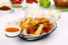 Mixed French Fries, chicken strips, onion rings. Mixed French fries, Nuggets, sausages and onion rings Stock Photo