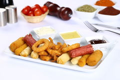 Mixed French Fries, chicken strips, onion rings. Mixed French fries, Nuggets, sausages and onion rings Stock Photography