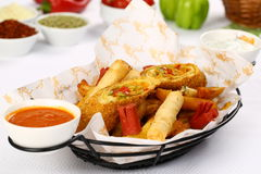 Mixed French Fries, chicken strips, onion rings. Mixed French fries, Nuggets, sausages and onion rings Stock Photos