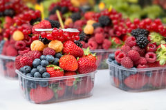 Mixed fresh berries. Ready to eat at the market Royalty Free Stock Photo