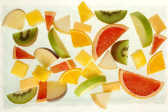 Mixed fresh fruit. Mixed fruit slices on white background Stock Photo