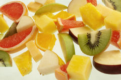 Mixed fresh fruit. Mixed fruit slices on white background Stock Photos