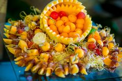 Mixed fresh fruit ball shape serve on melon skin bow. In the wedding banquet royalty free stock photos