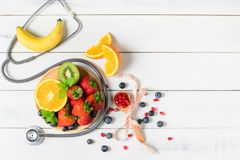 Free Mixed Fresh Fruit Salad With Strawberry With Stethoscope Stock Photography - 159591542