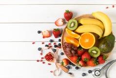 Free Mixed Fresh Fruit Salad With Strawberry With Stethoscope Stock Photo - 159591680