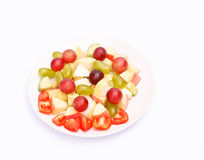Mixed fresh fruit and vegetables. Mixed fresh fruit and vegetables on plate Stock Photography