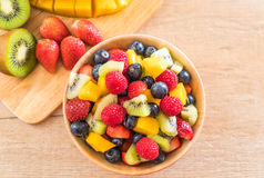 Mixed fresh fruits (strawberry, raspberry, blueberry, kiwi, mang. O) on wood bowl Stock Photos