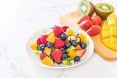 Mixed fresh fruits (strawberry, raspberry, blueberry, kiwi, mang Stock Images
