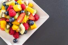 Mixed fresh fruits (strawberry, raspberry, blueberry, kiwi, mang Stock Image