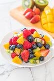 Mixed fresh fruits (strawberry, raspberry, blueberry, kiwi, mang Stock Photos