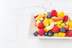Mixed fresh fruits (strawberry, raspberry, blueberry, kiwi, mang. O) on white plate Stock Images