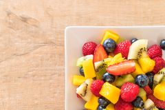 Mixed fresh fruits (strawberry, raspberry, blueberry, kiwi, mang. O) on white plate Royalty Free Stock Images