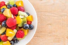 Mixed fresh fruits (strawberry, raspberry, blueberry, kiwi, mang. O) on white plate Stock Image