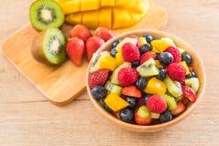 Mixed fresh fruits (strawberry, raspberry, blueberry, kiwi, mang. O) on wood bowl Stock Images