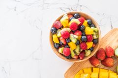 Mixed fresh fruits (strawberry, raspberry, blueberry, kiwi, mang Royalty Free Stock Image